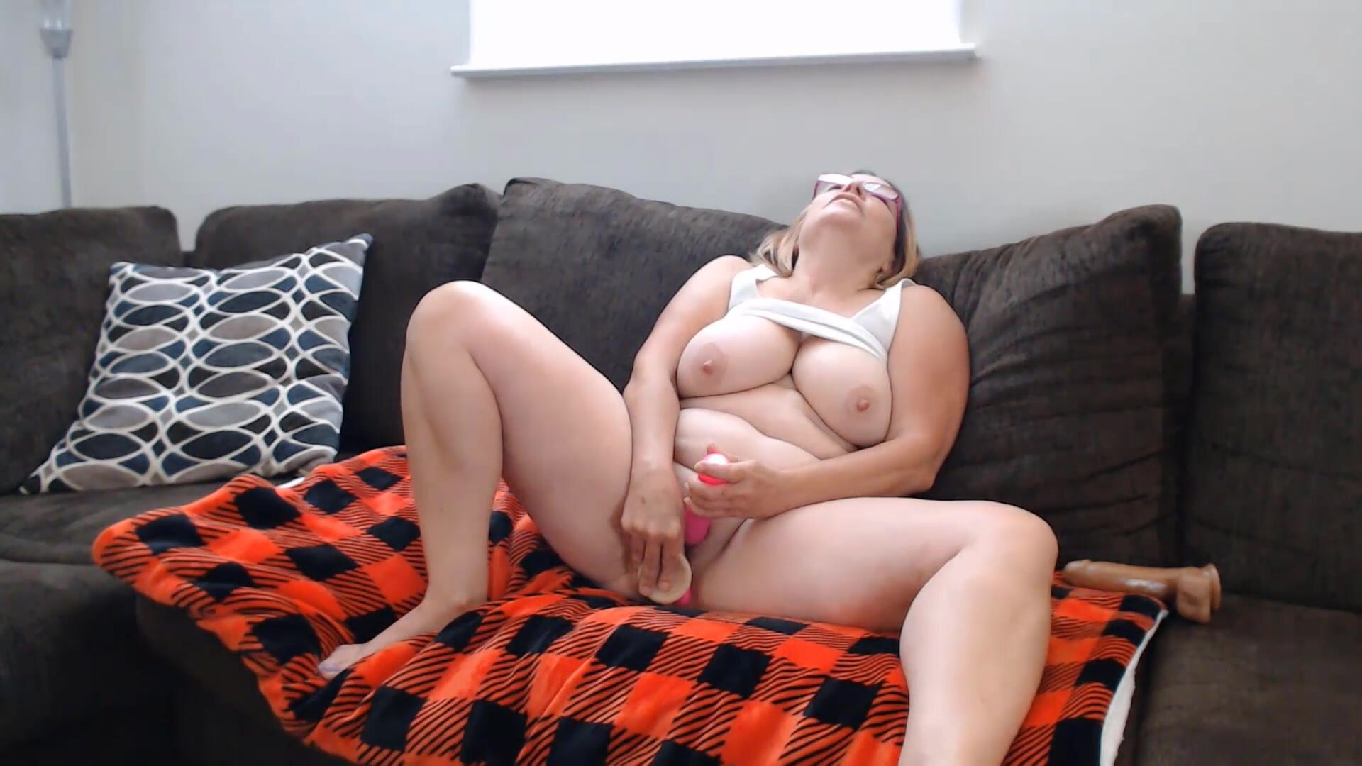 Mature MILF in glasses with huge natural tits and protruding nipples on livesexify.ne